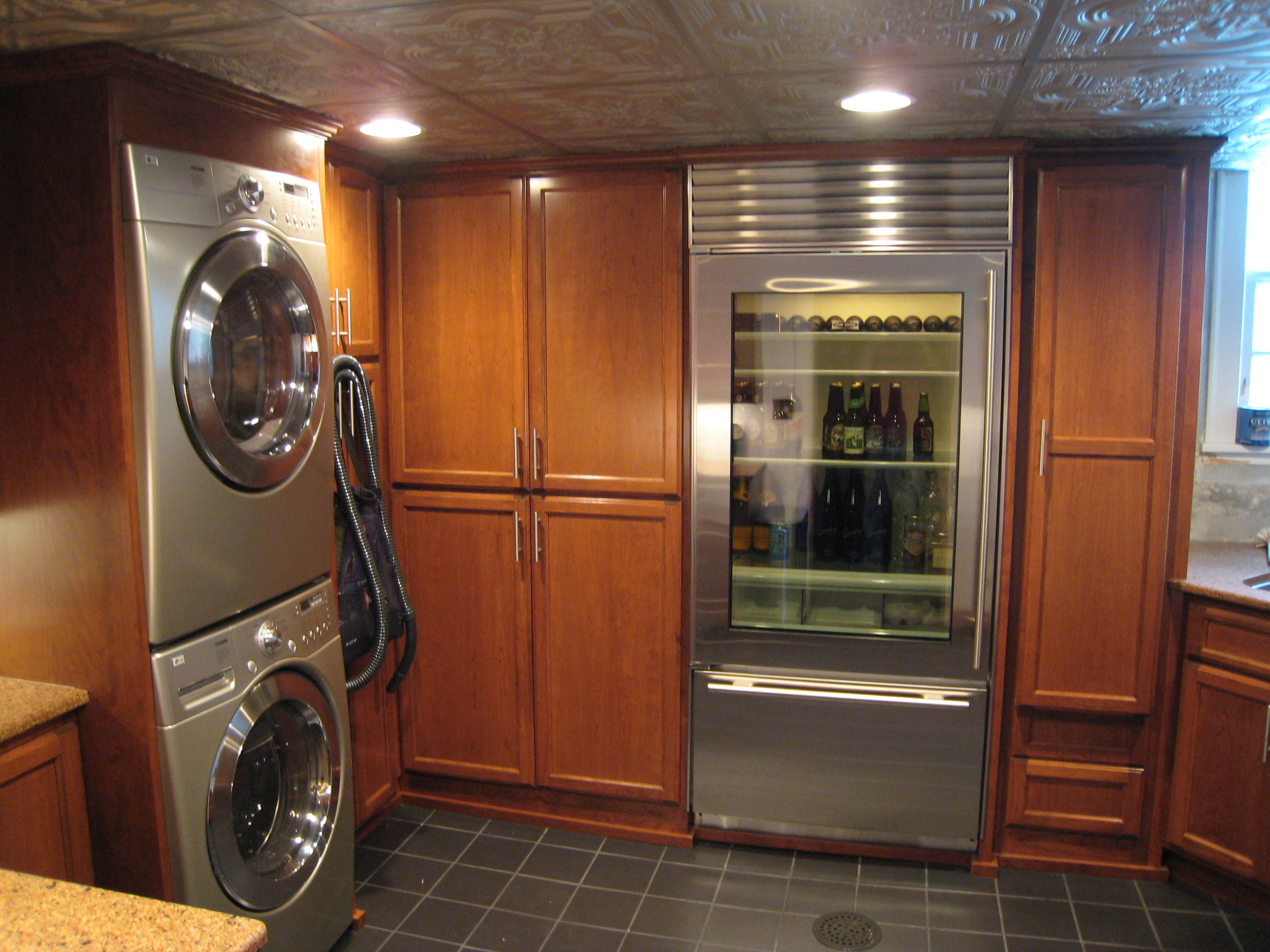 Custom laundry room cabinets gallery of cream wooden for Bathroom remodeling stores chicago